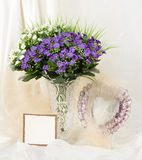 Spring flowers in a glass vase Royalty Free Stock Images