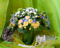 Spring flowers in a glass vase and frame Royalty Free Stock Images