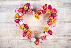 Spring Flowers with heart shaped border frame Stock Photo
