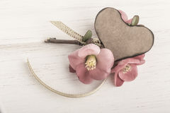 Spring flowers and heart shaped card on wooden background Stock Photos