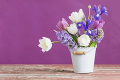 Free Spring Flowers In Bucket On Pink Background Stock Photography - 110924262