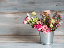 Spring Flowers In Small Tin Bucket Royalty Free Stock Images