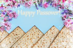 Spring flowers and matzah. Machine-made matzot from Jerusalem and spring flowers, inscription  - Happy Passover royalty free stock photography
