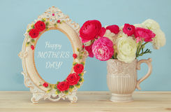 spring flowers next to photo frame. Mothers day concept royalty free stock image