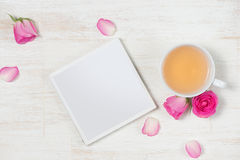 Spring flowers. Pink flowers on white wooden background. Flat la. Y, top view Royalty Free Stock Photos