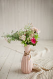 Spring flowers in pink vase on white background Royalty Free Stock Images