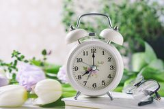 Spring flowers and retro Alarm Clock. royalty free stock images