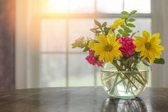 Spring flowers on table in vase with dark greys and blacks with. Open window fresh concept and copyspace Royalty Free Stock Images