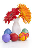 Spring flowers in vase with easter eggs Royalty Free Stock Photos