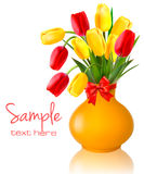 Spring flowers in a vase with a red bow and ribbon Royalty Free Stock Image