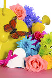 Spring Flowers and Watering Can Royalty Free Stock Photos