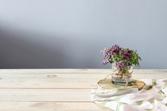 Spring flowers and white towel on the wooden desk stock images