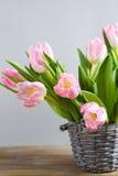 Spring flowers in a wicker bucket Stock Image