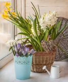 Spring flowers on the windowsill with braided heart, a romantic Stock Photo