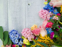 Spring flowers on wood background. Summer blooming border on a w Stock Image