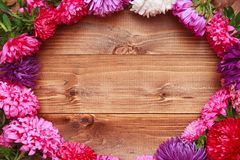 Spring flowers on wooden background Royalty Free Stock Photography