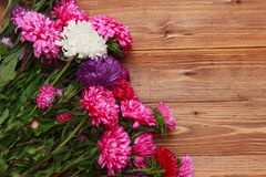 Spring flowers on wooden background Stock Photo