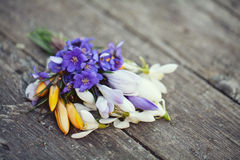 Spring flowers on wooden table Royalty Free Stock Image