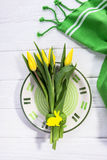 Spring flowers yellow tulips. Festive table setting for Easter. Happy holiday Stock Images