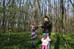 Family: Mother receiving flower  Stock Image