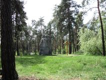 A city tour of Kiev monument to prisoners of war who died in a concentration camp. Spring forest green grass city tour of Kiev monument to prisoners of war who Royalty Free Stock Photo