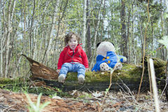 Spring in the forest little girl playing with a toy bear. Royalty Free Stock Images