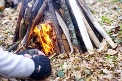 In the spring forest a tent with a fire a Royalty Free Stock Images