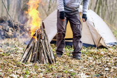 In the spring forest a tent with a fire a Stock Photo