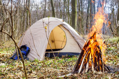 In the spring forest a tent with a fire a. In the spring forest a tent with a fire Stock Photos