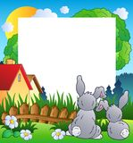 Spring frame with two rabbits Royalty Free Stock Photos