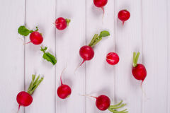 Spring fresh radishes background. On white table Royalty Free Stock Photos