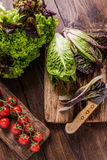 Spring fresh vegetable on wooden table, clean eating Royalty Free Stock Photo