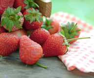 Spring fruits, strawberries in an aluminum bucket on a vintage wooden table Royalty Free Stock Image