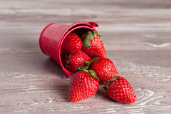 Spring fruits, strawberries in an aluminum bucket. On a vintage wooden table, close up Royalty Free Stock Photography