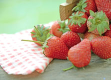 Spring fruits, strawberries in wooden bucket on a vintage wooden table Stock Photography