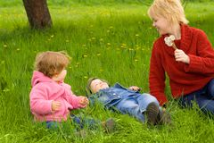Spring fun with the family. Mother and young children enjoying the spring with seasonal fun activities Stock Images