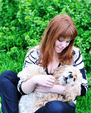 Spring fun of girl and her dog Royalty Free Stock Photo
