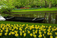 Spring garden with canal and boat Stock Images