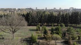Spring garden in the city. Spring flying with quadrocopter in the old Ukrainian city garden stock footage