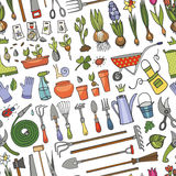 Spring garden doodle seamless pattern.Colored tools,plants Royalty Free Stock Image