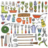 Spring garden doodle set.Colored tools,plants Stock Photos