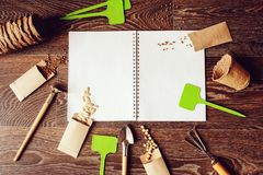 Spring garden flat lay with seeds in handmade envelopes. Note book, labels and tools. Seeding vegetables and potherbs, planning and spring preparations royalty free stock photography