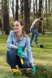 Spring in the garden- garden work. Spring in the garden- women during garden work stock image