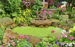 Spring garden with green pond Royalty Free Stock Photo