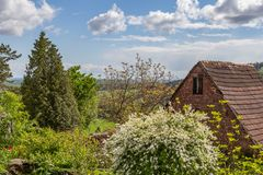 Spring garden. Hut in a beautiful blooming garden royalty free stock photo