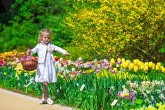 Spring garden, spring flowers, dorable little girl Stock Photography
