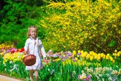 Spring garden, spring flowers, dorable little girl Royalty Free Stock Images