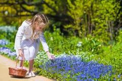 Spring garden, spring flowers, dorable little girl Stock Photo