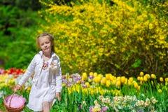 Spring garden, spring flowers, dorable little girl Stock Photos
