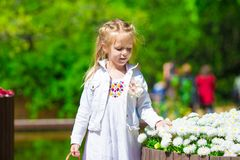 Spring garden, spring flowers, dorable little girl Royalty Free Stock Photography